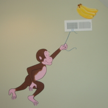 Curious George swinging from the vent.